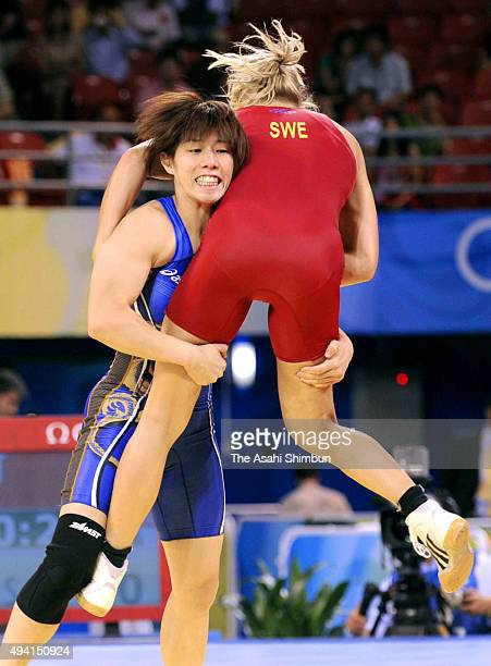 Saori Yoshida of Japan holds IdaTheres Nerell of Sweden during the Wrestling women's 55kg first round at the China Agriculture University Gymnasium...