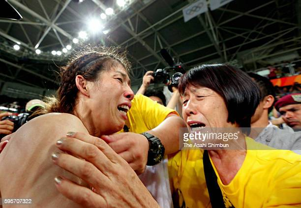 Saori Yoshida of Japan is consoled by her mother Yukiyo after her defeat in the Women's Freestyle 53 kg gold medal match on Day 13 of the Rio 2016...
