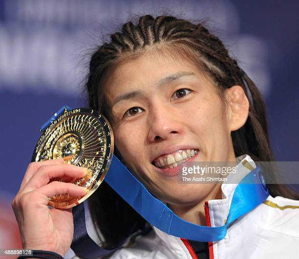 Saori Yoshida of Japan poses for photographs with her medal at the medal ceremony for the Women's -53kg during day three of the World Wrestling...