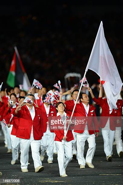Saori Yoshida of the Japan Olympic wrestling team carries her country's flag during the Opening Ceremony of the London 2012 Olympic Games at the...