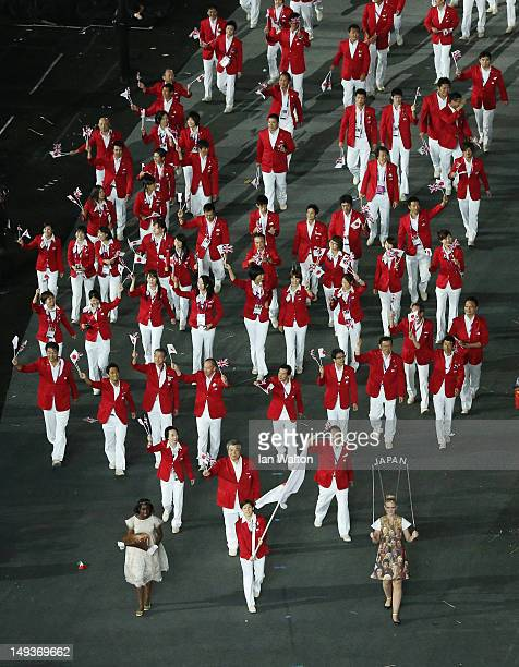 Saori Yoshida of the Japan Olympic wrestling team carries his country's flag during the Opening Ceremony of the London 2012 Olympic Games at the...