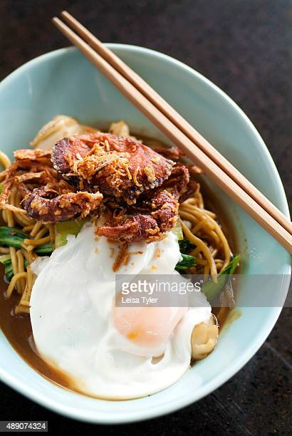 Sapam wokfried egg noodles with seafood and a poached egg an example of Baba cuisine a style developed in Phuket by Hokkien Chinese who migrated from...