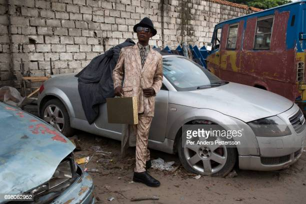 Sapeur from the group belonging to Papa Griffe poses for a portrait February 13 2016 in Kinshasa DRC The word Sapeur comes from SAPE a French acronym...
