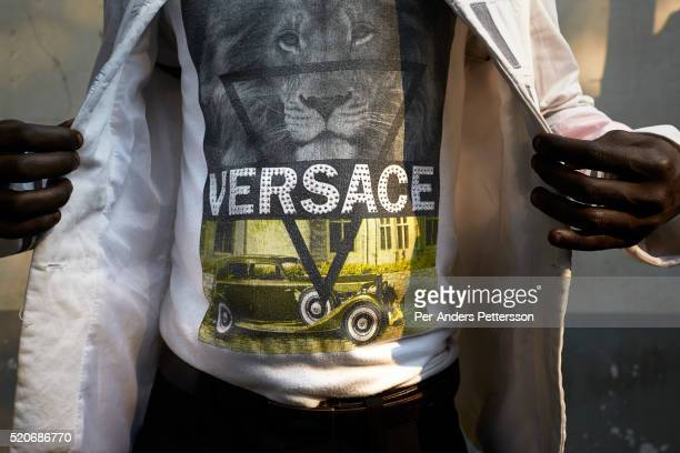 A Sapeur from the group Leopard de la Sape shows his Versace designer label clothes on July 16 in Kinshasa DRC The word Sapeur comes from SAPE a...