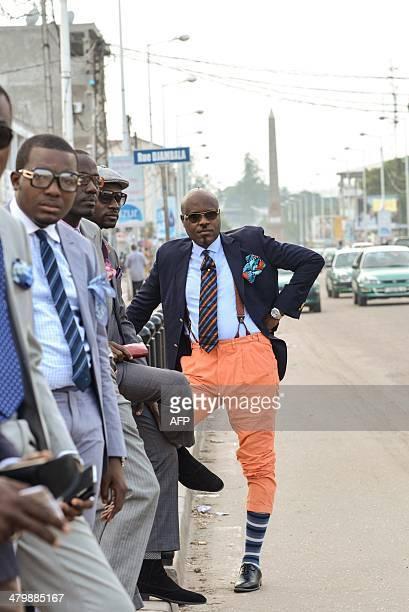 Sapeur Hassan Salvador son of famous Sapeur Hassan Malanda and member of 'La Sape' movement the acronym for 'Societe des Ambianceurs et des Personnes...