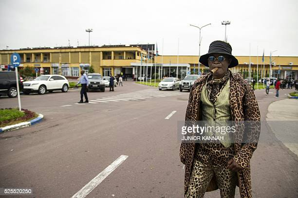 Sapeurs fans of late Congolese rumba star Papa Wemba arrive near Ndjili airport in Kinshasa on April 28 during the repatriation of the body of Papa...