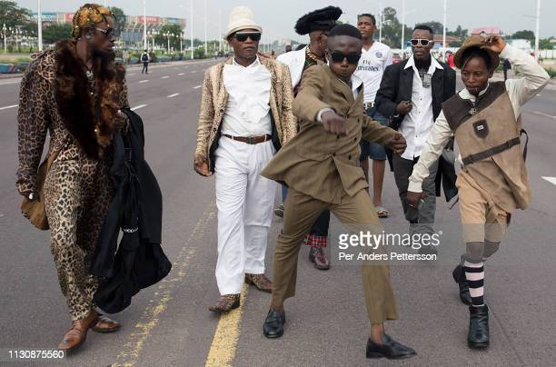 Sapeurs from a group belonging to Papa Griffe, a Sapeur leader, walks on Avenue De La Democratie on February 10, 2016 in Kinshasa, DRC. The word...