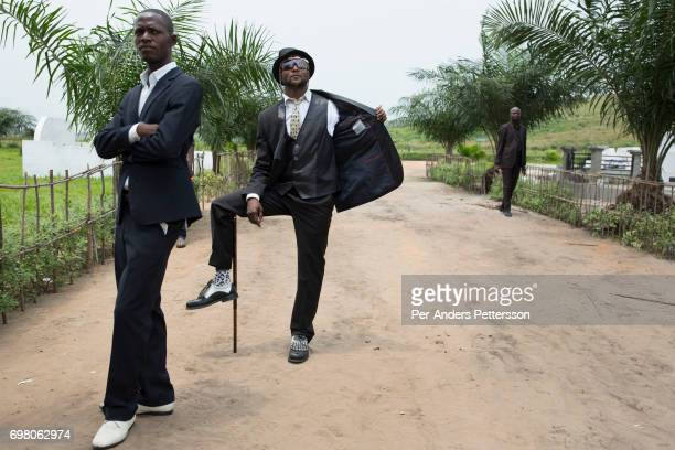 Sapeurs pay their respects at the grave of the legendary musician King Kester Emeneya on February 13 2016 in Kinshasa DRC The word Sapeur comes from...