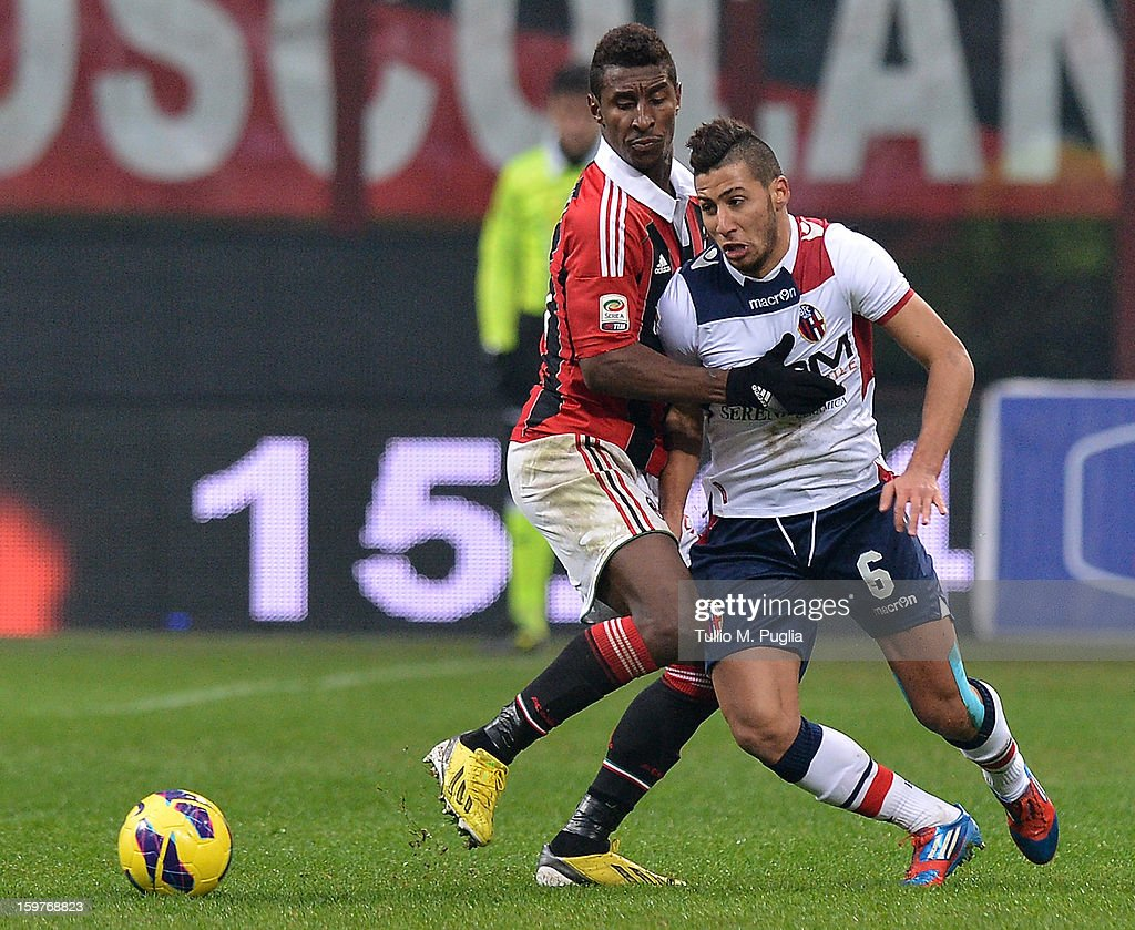 Saphir Sliti Taider (R) of Bologna and Kevin Constant of Milan compete for the ball during the Serie A match between AC Milan and Bologna FC at San Siro Stadium on January 20, 2013 in Milan, Italy.