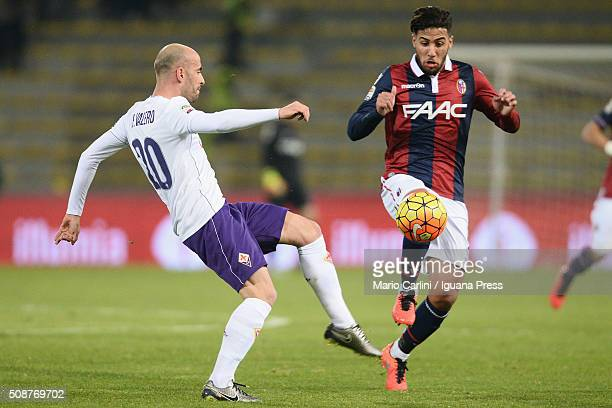Saphir Taider of Bologna FC competes the ball with Borja Valero of ACF Fiorentina during the Serie A match between Bologna FC and ACF Fiorentina at...
