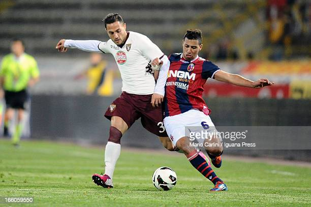 Saphir Taider of Bologna FC competes the ball with Danilo D'Ambrosio of Torino FC during the Serie A match between Bologna FC and Torino FC at Stadio...