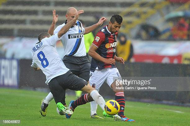 Saphir Taider of Bologna FC competes the ball with Esteban Cambiasso of FC Internazionale and Rodrigo Palacio of FC Internazionale during the Serie A...