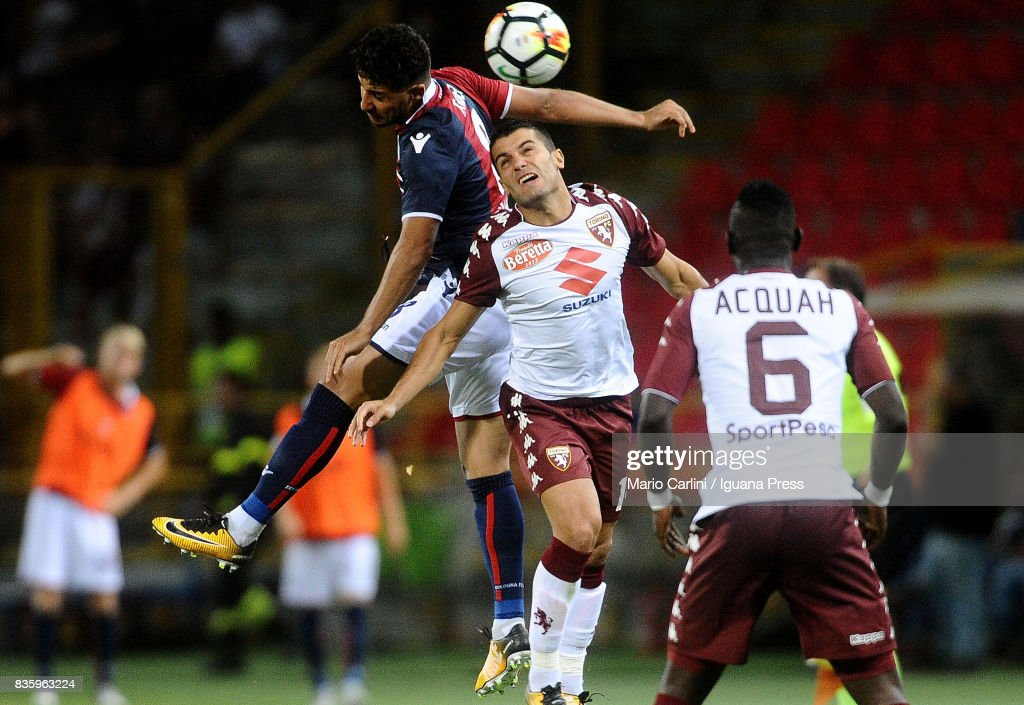 Saphir Taider # 8 of Bologna FC ( L ) wins a header with Iago Falque # 14 of Torino FC ( R ) during the Serie A match between Bologna FC and Torino FC at Stadio Renato Dall'Ara on August 20, 2017 in Bologna, Italy.