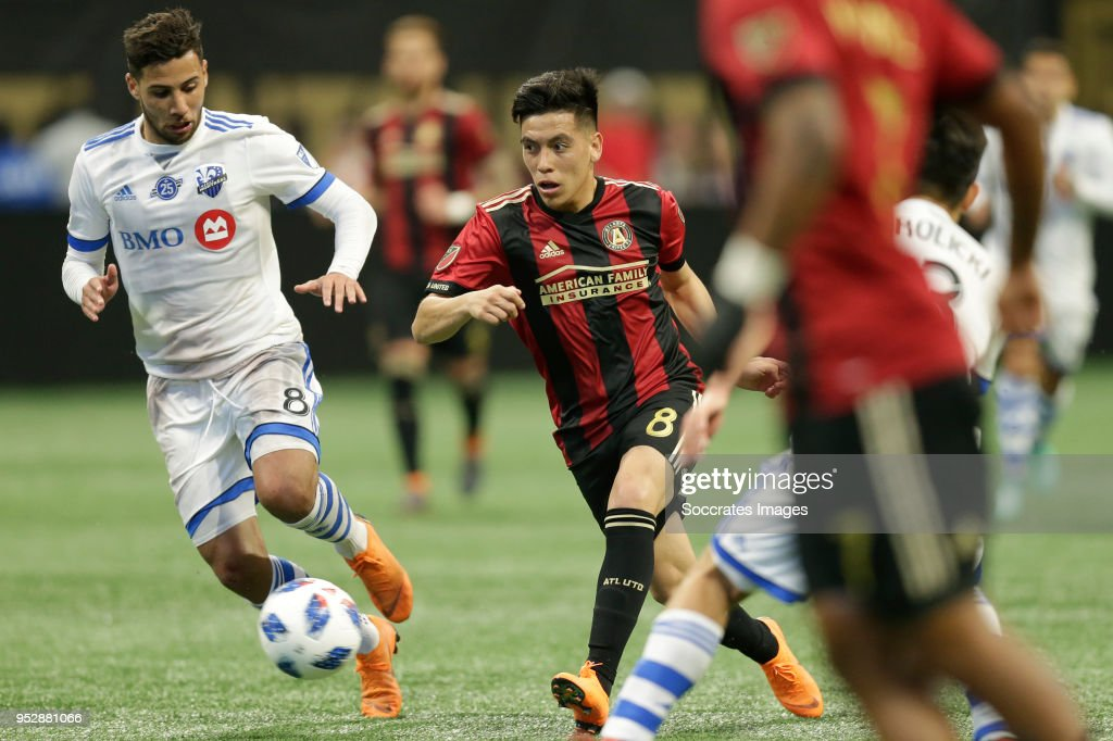Saphir Taider of Montreal Impact , Ezequiel Barco of Atlanta United during the match between Atlanta United FC v Montreal Impact at the Mercedes-Benz Stadium on April 28, 2018 in Atlanta United States