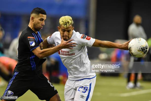 Saphir Taider of the Montreal Impact and German Mejia of CD Olimpia battle for the ball in the second half during the 1st leg of the CONCACAF...