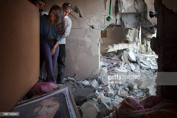 Sapir Hachmon and her boyfriend Ron Vachnish react as they enter her room after it was hit by a rocket fired from the Gaza Strip on November 20 2012...