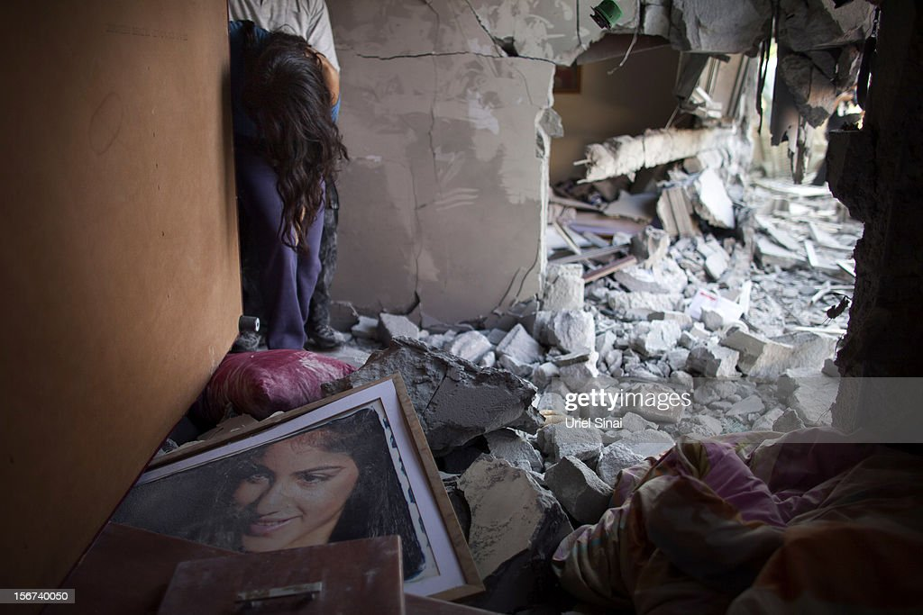 Sapir Hachmon reacts as she enters her room after it was hit by a rocket fired from the Gaza Strip on November 20, 2012 in Beersheba, Israel. Hamas militants and Israel are continuing talks aimed at a ceasefire as the death toll in Gaza reaches over 100 with three Israelis also having been killed by rockets fired by Palestinian militants.