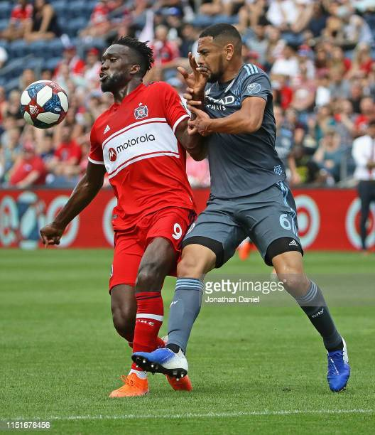 Sapong of Chicago Fire and Alexander Callens of New York City battle for the ball at SeatGeek Stadium on May 25, 2019 in Bridgeview, Illinois. The...