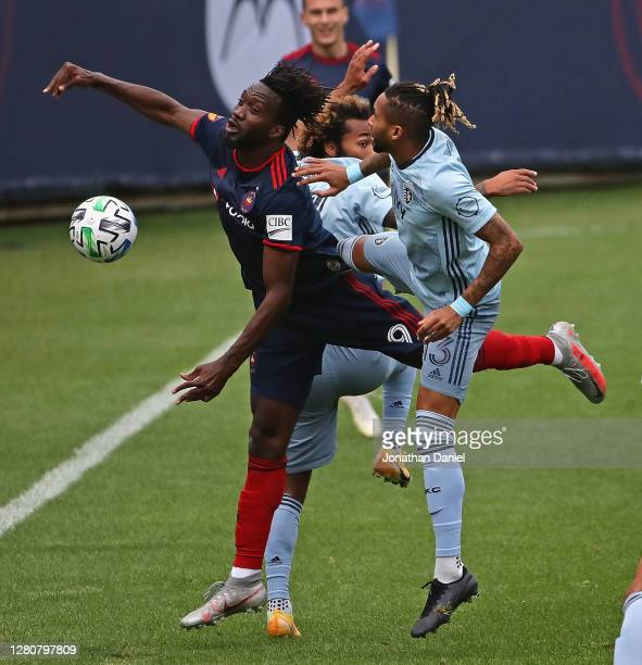 J Sapong of Chicago Fire FC battles for the ball with Amadou Dia and Gianluca Busio of Sporting Kansas City at Soldier Field on October 17 2020 in...