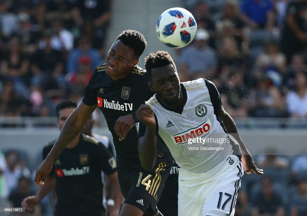 C.J. Sapong #17 of Philadelphia Union and Mark-Anthony Kaye #14 of Los Angeles FC vie for the ball in the first half during the MLS match at Banc of California Stadium on June 30, 2018 in Los Angeles, California.