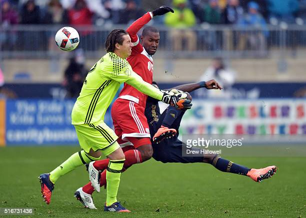 J Sapong of Philadelphia Union gets fouled by Jose Goncalves of New England Revolution while taking a shot on goalkeeper Bobby Shuttleworth at Talen...