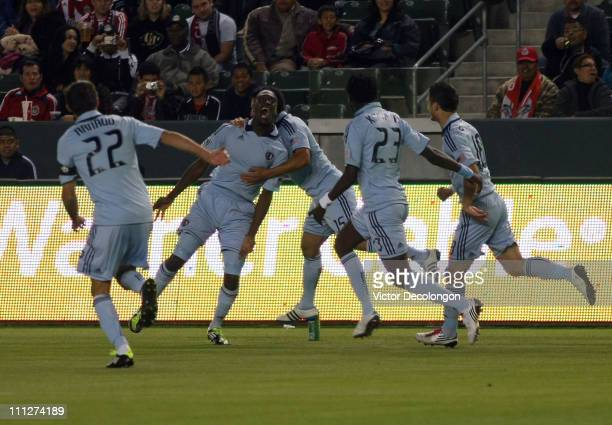 J Sapong of Sporting Kansas City celebrates his first half goal with teammates against Chivas USA during the MLS match at The Home Depot Center on...
