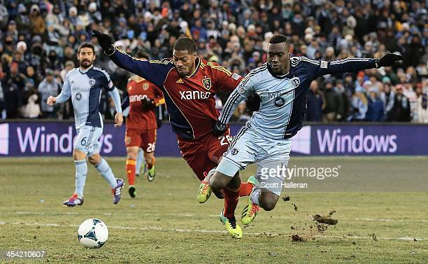 J Sapong of Sporting KC fights for the ball against Chris Schuler of Real Salt Lake in the second half of the 2013 MLS Cup at Sporting Park on...