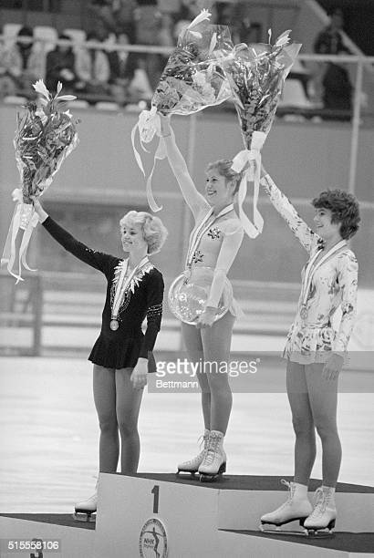 Women's singles winners wave flower bouquets during awarding ceremony in the International Figure Skating Competitions at Makomanai indoor skating...