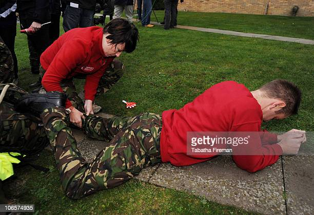 Sapper Darren Pallatina and physiotherapist Arlene Holmes examine weary muscles shortly after the team of Royal Engineers from 39 Engineer Regiment...