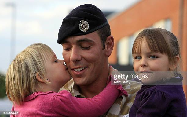 Sapper Russell Kirkham from 33 Armoured Engineer Squadron is welcomed home by his daughters Kaitlyn and Courtney at Swinton Barracks Perham Down on...