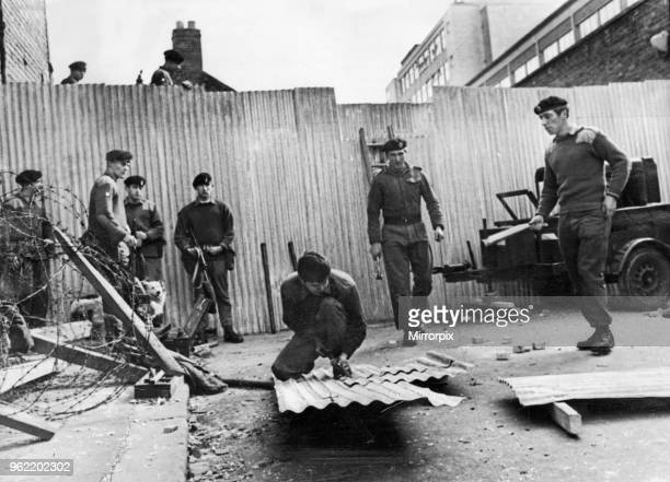 Sappers of the Royal Engineers erect stockade style barricades in Coates Street of the Falls Road in Belfast following attacks the previous day....