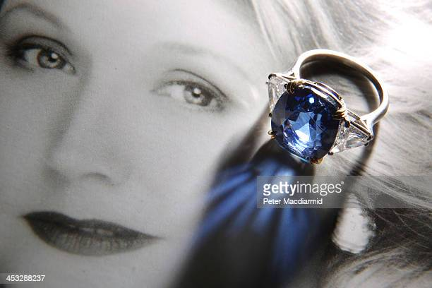 A sapphire and diamond ring by Harry Winston from the collection of author Barbara Taylor Bradford is displayed at Bonhams on December 3 2013 in...