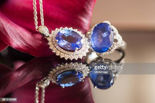 sapphire diamond ring、neckless and flower - sapphire stock pictures, royalty-free photos & images