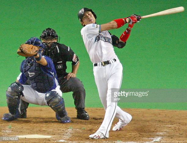 Former New York Mets outfielder Tsuyoshi Shinjo of the Pacific League champion Nippon Ham Fighters strikes out swinging at his lastbatting of his...