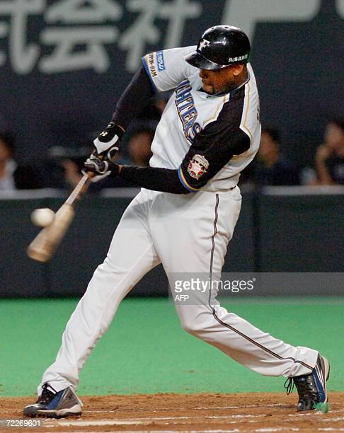 Former Yankees infielder Fernando Seguigno of the Pacific League champion Nippon Ham Fighters hits a tworun homer during the Japan Series baseball in...