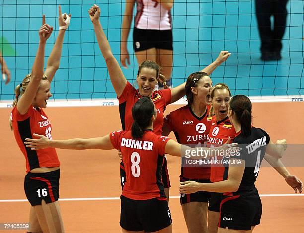 German vollyball players Margareta Kozuch Cornelia Dumler Christina Benecke Angelina Grun Tanja Hart and Kerstin Tzscherlich celebrate their victory...