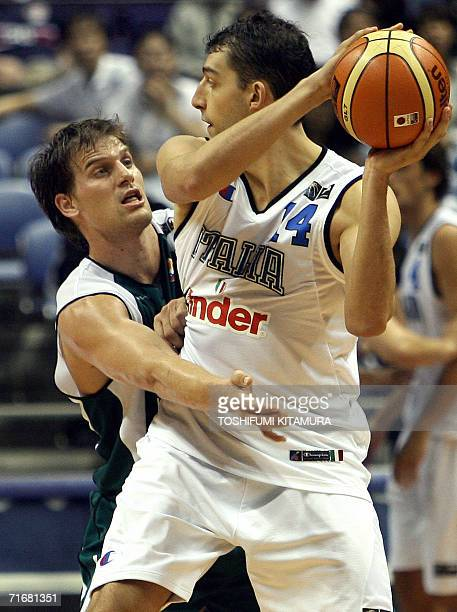 Italy's Luca Garri looks for an open man as he is defended by Slovenia's Jaka Lakovic during their Group D preliminary round match on the second day...