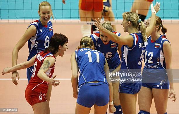 Russian volleyball players Elena Godina Svetlana Kryuchkova Ekaterina Gamova Yulia Merkulova Lioubov Shashkova and Marina Sheshenina celebrate their...