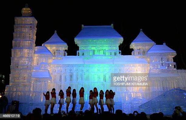 Sapporo's local idol group Team Crereco performs on a stage in front of a10metretall and 18metrewide ice statue of the National Palace Museum in...