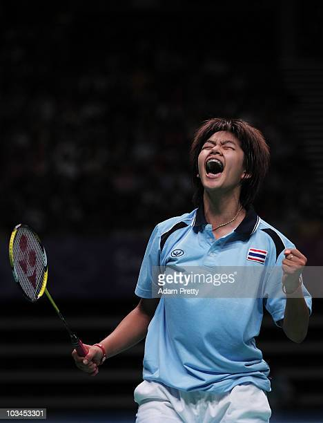 Saps Taerattanachai of Thailand celebrates winning the Gold Medal over Deng Xuan of China in the Badminton Girls Singles on day five of the Youth...