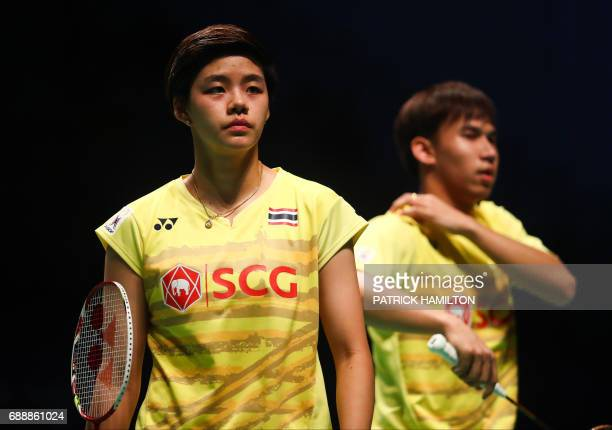 Sapsiree Taerattanachai and Dechapol Puavaranukroh of Thailand react to a point during the mixed doubles Sudirman Cup match against Chae Yoo Jung and...