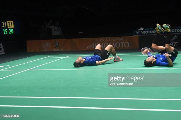 Sapsiree Taerattanachai and Dechapol Puavaranukroh of Thailand celebrate their victory against Goh Soon Huat and Shevon Jemie Lai of Malaysia during...