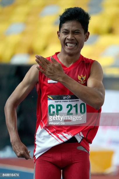 Sapto Yogo Purnomo of Indonesia celebrates after winning in the Men 100 meters T38 Final during the 2017 ASEAN Para Games at the Bukit Jalil National...