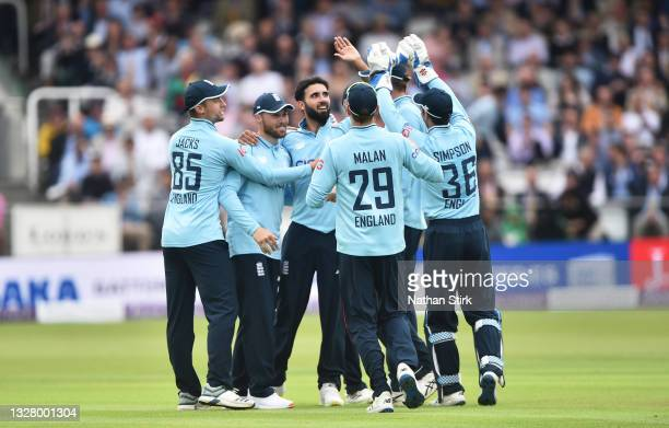 Saqib Mahmood of England celebrates with his teammates after getting Mohammad Rizwan of Pakistan out during the 2nd Royal London Series One Day...
