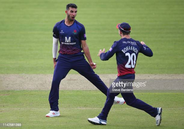 Saqib Mahmood of Lancashire celebrates taking the wicket of Ross Taylor of Middlesex with Josh Bohannon during the Royal London One Day Cup Quarter...