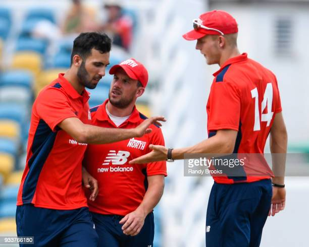 Saqib Mahmood Steven Mullaney and Zak Chappell of North celebrates the dismissal of Sam Curran of South during the ECB North v South Series match One...