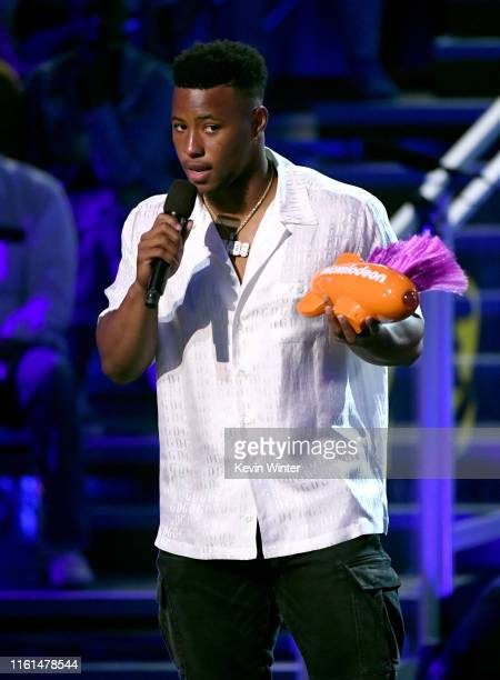 Saquon Barkley accepts the Favorite Breakout Player award onstage during Nickelodeon Kids' Choice Sports 2019 at Barker Hangar on July 11 2019 in...