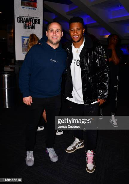Saquon Barkley and guest attend Top Rank VIP party prior to the WBO welterweight title fight between Terence Crawford and Amir Khan at Madison Square...