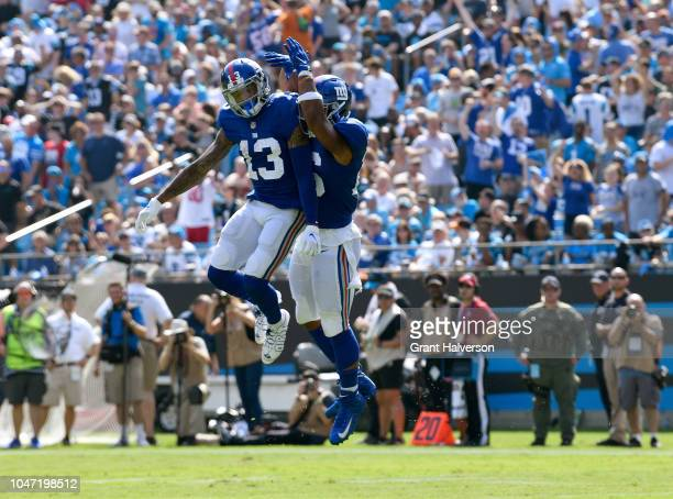 Saquon Barkley and teammate Odell Beckham Jr #13 of the New York Giants celebrate a touchdown against the Carolina Panthers in the second quarter...