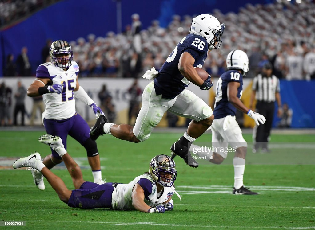 Saquon Barkley #26 of Penn State Nittany Lions leaps over defender Myles Bryant #5 of the Washington Huskies during the second quarter of the Playstation Fiesta Bowl at University of Phoenix Stadium on December 30, 2017 in Glendale, Arizona. Penn State won 35-28.